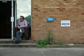Sitting in an armchair entrance to a factory unit Reserved for director parking space, rundown Industrial estate Stratford upon Avon - John Harris - 2010s,2015,adult,adults,capitalism,capitalist,closed,closing,closure,closures,director,DIRECTORS,disused,EBF,Economic,Economy,employee,employees,Employment,entrance,FACTORIES,factory,Industries,indust