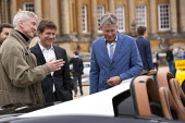 Tiff Needell and judges Salon Prive Supercar Show Blenheim Palace Oxfordshire - John Harris - wealth,2010s,2015,AFFLUENCE,AFFLUENT,AUTO,AUTOMOBILE,AUTOMOBILES,AUTOMOTIVE,Bourgeoisie,broadcaster,car,cars,communicating,communication,conversation,conversations,dialogue,discourse,DISCUSS,discusses