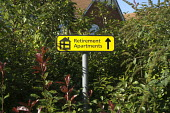 Retirement Apartments sign, Stratford Upon Avon - John Harris - 2010s,2015,accommodation,adult,adults,age,ageing population,apartment,apartments,communicating,communication,EBF,Economic,Economy,elderly,Housing,MATURE,oap,oaps,old,pension,pensioner,pensioners,pensi