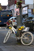 A Ghost Bike, bicycle painted white as a roadside memorial where a cyclist was run over and killed by a vehicle, Birmingham. Also intended to remind drivers of road safety. - John Harris - 29-09-2015