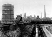 Corby steelworks railhead, as the plant is closed down. Gasometer still has a slogan from the steel strike- All Out. - John Harris - 20-10-1980