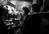 Couple drinking in a public house - John Harris - 1980s,1981,adult,adults,Alcohol,and,bar,BARS,beer,class,couple,COUPLES,drink,drinking,house,houses,husband,Leisure,LICENSED,MATURE,pint,PINTS,pub,public,PUBLIC HOUSE,PUBLIC HOUSES,PUBS,RECREATION,RECR