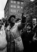 Marxist revolutionary (Revolutionary Communist Party member) heckling speaker at anti racist meeting following the murder of an asian girl by racists Coventry 1981 - John Harris - ,1980s,1981,asian,BAME,BAMEs,bigotry,black,BME,bmes,communists,DISCRIMINATION,diversity,equal,equality,ethnic,ethnicity,INEQUALITY,Marxist,Marxists,meeting,MEETINGS,minorities,minority,murder,MURDERED