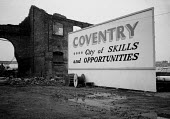 Sign welcoming new arrivals with the prospect of employment and job opportunities in Coventry as the recession leads to factory closures and the destruction of manufacturing and engineering industry.... - John Harris - deindustrialisation, Deindustrialization,1980s,1981,billboard,BILLBOARDS,capitalism,cities,City,communicating,communication,DESTROYED,destruction,DOWNTURN,EBF,Economic,Economy,eu,european,europeans,eu