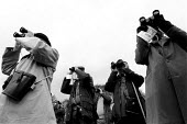 Watching a Race meeting in the Cotswolds attended by landed gentry and wealthy. - John Harris - 1980s,1981,AFFLUENCE,AFFLUENT,Binocular,Binoculars,Bourgeoisie,class,Cotswold,Cotswold Hills,Cotswolds,country,countryside,elite,elitism,EQUALITY,Equestrian,equine,high,high income,horse racing,income