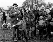 Enjoying a drink at a Race meeting in the Cotswolds attended by landed gentry and wealthy. - John Harris - 1980s,1981,AFFLUENCE,AFFLUENT,barber,Bourgeoisie,child,CHILDHOOD,children,class,Cotswold,Cotswold Hills,Cotswolds,country,countryside,dog,DOGS,drink,drinking,elite,elitism,Enjoying,ENJOYMENT,EQUALITY,