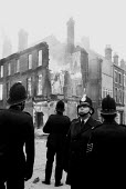 Police at dawn amongst the aftermath of a weekend of some of the worst inner city urban riots in mainland Britain. Many accuse the police of racism. Toxteth riots, Liverpool 1981 - John Harris - 1980s,1981,adult,adults,bigotry,civil,CLJ,conflict,conflicts,dawn,destroyed,destruction,DISCRIMINATION,equal,equality,fire,fires,force,INEQUALITY,Liverpool,Liverpool 8,MATURE,Officer,officers,Police,p