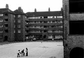 Children playing amongst the decaying housing on an inner city estate in Toxteth Liverpool an area of multiple deprivation high unemployment high crime rate dependency on welfare and low incomes with... - John Harris - 1980s,1981,BAME,BAMEs,Black,BME,bmes,child,CHILDHOOD,children,crime,deprivation,diversity,EQUALITY,ethnic,ethnicity,excluded,exclusion,HARDSHIP,housing,impoverished,impoverishment,INEQUALITY,jobless,j