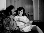 Couple enjoying a drink, Toxteth Liverpool an area of high unemployment multiple deprivation and dependency on welfare 1981 - John Harris - 1980s,1981,adult,adults,BAME,BAMEs,black,BME,BME Black minority ethnic,bmes,common,Couple,COUPLES,cultural,diversity,enjoying,ENJOYMENT,EQUALITY,ethnic,ethnicity,excluded,exclusion,exploitation,female