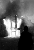 Police at dawn amongst the aftermath of a weekend of some of the worst inner city urban riots in mainland Britain. Many accuse the police of racism Toxteth riots, Liverpool 1981 - John Harris - ,1980s,1981,adult,adults,bigotry,burn,burning,BURNS,civil,CLJ,CLJ crime law and justice,conflict,conflicts,dawn,destroyed,destruction,DISCRIMINATION,equal,equality,fire,fires,flame,flames,force,INEQUA