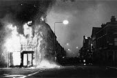 Toxteth riots, Liverpool 1981. Police at dawn amongst the aftermath of a weekend of some of the worst inner city urban riots in mainland Britain. - John Harris - 1980s,1981,adult,adults,burn burning,cities,City,civil unrest,CLJ,conflict,Conflicts,conflicts conflict,dawn,destruction destroyed,fire,fires,flame flames,force,Liverpool,Liverpool 8,MATURE,OFFICER,of