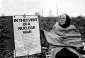 Embrace the base women protest at Greenham Common USAF American Airforce Base from which cruse missile launchers were deployed. 1982 - John Harris - 1980s,1982,activist,activists,Air force,Airbase,airbases,Airforce,American,americans,Anti War,Antiwar,armed forces,atomic,bomb,BOMBS,Campaign,Campaign for Nuclear Disarmament,campaigner,campaigners,CA