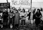 Embrace the base women protest at the perimeter fence, Greenham Common USAF American Airforce Base from which cruse missile launchers were deployed. 1982 - John Harris - 1980s,1982,activist,activists,Air force,Airbase,airbases,Airforce,American,americans,Anti War,Antiwar,armed forces,atomic,bomb,BOMBS,Campaign,Campaign for Nuclear Disarmament,campaigner,campaigners,CA