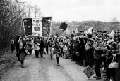 1983 Women for Peace and 70,000 women protesters forming a 14 mile human chain between Greenham Common USAF American Airforce Base from which cruse missile launchers were deployed to Burghfield, Alder... - John Harris - 1980s,1983,activist,activists,against,Air force,Airbase,airbases,Airforce,American,americans,Anti War,Antiwar,armed forces,atomic,banner,banners,bomb,BOMBS,CAMPAIGN,Campaign for nuclear disarmament,ca