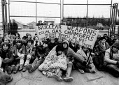 Blockade the base women protest by sitting down at Greenham Common USAF American Airforce Base from which cruse missile launchers were deployed. 1982 ... - John Harris - 1980s,1982,activist,activists,Air force,Airbase,airbases,Airforce,American,americans,anti war,Antiwar,armed forces,atomic,Blockade,Blockades,Blockading,bomb,BOMBS,Campaign,Campaign for Nuclear Disarma