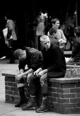 Skinheads with doc martin boots and union jack badges hanging around Coventry shopping precinct 1982 as recession intensifies and unemployed youth are targeted by right wing political parties - John Harris - 30-03-1982