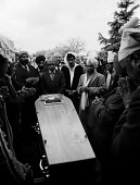 Relatives mourning at the funeral of Satnam Singh Gill a young asian man murdered by racists in the street in front of his parents Coventry 1981 - John Harris - ,1980s,1981,asian,BAME,BAMEs,bigotry,black,BME,bmes,crime,death,DEATHS,died,DISCRIMINATION,diversity,equal,equality,ethnic,ethnicity,families,FAMILY,far right,far right,fascism,fascist,fascists,funera