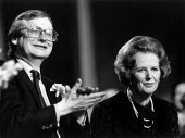 John Gummer MP applauding Margaret Thatcher Prime Minister at Conservative Party conference 1982 - John Harris - ,1980s,1982,applauding,APPLAUSE,conference,conferences,CONSERVATIVE,Conservative Party,conservatives,EMOTION,EMOTIONAL,EMOTIONS,female,Minister,Party,people,person,persons,POL politics,SMILE,SMILES,sm