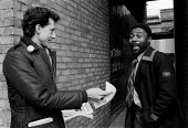 Peter Tatchell Labour candidate canvassing during the Bermondsey by-election. A local rejects a leaflet. Peter was ridiculed for being gay and looney left by the press and lost. 1983 - John Harris - 1980s,1983,anti gay,antigay,BAME,BAMEs,black,BME,bmes,campaign,campaigning,CAMPAIGNS,candidate,candidates,CANVASING,canvassing,DEMOCRACY,diversity,election,elections,electorate,equal,equality,ethnic,e
