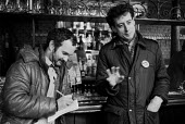 Peter Tatchell talking to a journalist from The Sun in a pub during the Bermondsey by-election. The Labour Party candidate he was ridiculed for being gay and looney left by the press and lost. - John Harris - 01-02-1983