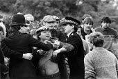 Police hold back a striking miner as a working miner hurls abuse. Nottinghamshire Mansfield colliery 1984 - John Harris - 1980s,1984,adult,adults,Argue,arguing,Argument,Assertion,Assertive,clj crime law and justice,coal,Coal Industry,coalfield,coalindustry,collieries,colliery,communicating,communication,conflict,conversa