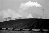 Coal stockpile at Ratcliffe-on-Soar coal fired power station to beat the miners strike, Nottinghamshire - John Harris - 1980s,1984,Coal,Coal Industry,coalindustry,disputes,EBF,Economic,Economy,ELECTRICAL,electricity,energy,environmental degradation,generator,INDUSTRIAL DISPUTE,member,member members,members,MINER,miners