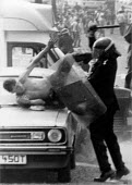 Senior police officer attacking a miner guarding his car. The attempt to prosecute the miner for riot collapsed. Orgreave coke works Miners strike Sheffield South Yorkshire - John Harris - 18-06-1984