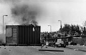 Picketing miners behind burning barricade. Orgreave coke works Miner's strike Sheffield South Yorkshire - John Harris - 29-05-1984