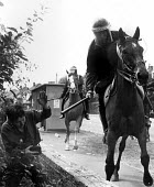 Police mounted on horseback attack Lesley Boulton from miners women's support group WAPC. Orgreave coke works mass picket, Miner's strike Sheffield South Yorkshire - John Harris - 1980s,1984,adult,adults,attack,attacking,Battle of Orgreave,BSC,CLJ,coke works,coking plant,DISPUTE,DISPUTES,Domesticated Ungulates,equestrian,equine,FEMALE,force,HORSE,horseback,HORSES,INDUSTRIAL DIS