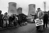 Mass picket of striking miners attempting to stop oil being delivered by road to Didcot Power Station Oxfordshire, where NUR railway workers are refusing to handle new coal stocks. - John Harris - ,1980s,1984,breaker,breakers,breaking,coal,coal industry,coalindustry,cross,crosses,crossing,DISPUTE,DISPUTES,electricity generator,energy supply,Fuel,highway,INDUSTRIAL DISPUTE,Mass,member,member mem