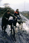 Striking miners collecting coal from waste slag heap at a pit to keep them warm. Miners strike Yorkshire coalfield 1985 - John Harris - 1980s,1985,bicycle,bicycles,BICYCLING,Bicyclist,Bicyclists,BIKE,BIKES,coal,Coal Industry,Coal Mine,coalindustry,collecting,cycle,cycles,cycling,Cyclist,Cyclists,dangerous,disputes,Elsecar,hardship,haz