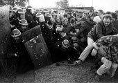 Striking miners pull line of riot police with long shields to the ground, Mass picket Kellingley colliery North Yorkshire. - John Harris - 26-02-1985