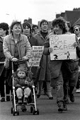 Miner's Wives support group leading a demonstration of striking miners before the return to work as the strike ends. Rossington pit village - John Harris - 04-03-1985