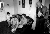 Mother Father children and grandfather at home in Kirby, an area of high unemployment, poverty, multiple deprivation, dependency on welfare and poor housing. Liverpool 1986 - John Harris - 04-01-1986