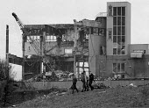 Schoolboys pass a factory being demolished as they walk home from school Aston Birmingham- once a thriving industrial area 1987 - John Harris - ,1980s,1987,adolescence,adolescent,adolescents,capitalism,capitalist,child,CHILDHOOD,children,Comprehensive School,deindustrialisation,Deindustrialization,DOWNTURN,EBF,EBF economy,Economic,Economy,edu