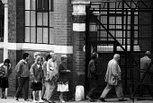 Unemployed at a DHSS benefit office Coventry during recession in manufacturing 1987 - John Harris - ,1980s,1987,benefit,benefits,BENIFIT,BENIFITS,capitalism,capitalist,CLAIMANT,Claimants,deindustrialisation,Deindustrialization,dole,DOWNTURN,EBF,Economic,Economy,families,family,female,Industries,INDU