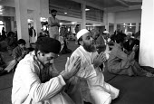 Muslim men praying and worshipping at the Birmingham Central mosque ~... - John Harris - 26-04-1987