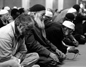 Muslim men praying and worshipping at the Birmingham Central mosque ~... - John Harris - ,1980s,1987,BAME,BAMEs,Birmingham,black,BME,bmes,diversity,ethnic,ethnicity,ISLAM,ISLAMIC,minorities,minority,monotheistic,mosque,mosques,MUSLEM,Muslim,Muslims,people,poc,RLB religion & belief,West Mi