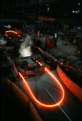 Rolling out iron in a steel mill in the Midlands - John Harris - ,1980s,1988,BME Black minority ethnic,British Steel,BSC,capitalism,capitalist,EBF,EBF Economy,Economic,Economy,employee,employees,Employment,FACTORIES,factory,FOUNDRIES,Foundry,hazard,hazardous,hazard