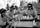 Egg packing production line Many work part time shifts. Farm Eggs Factory. - John Harris - 1980s,1988,capitalism,capitalist,EARNINGS,EBF,EBF economy business,Economic,Economy,eggs,EQUALITY,Farm,female,food,Food Processing Industry,FOODS,Income,INCOMES,Industries,industry,inequality,job,jobs
