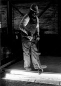 Picking up hot iron in a steel mill, Midlands - John Harris - 1980s,1988,BAME,BAMEs,black,BME,BME Black minority ethnic,bmes,British Steel,BSC,capitalism,capitalist,diversity,EBF,EBF Economy,Economic,Economy,employee,employees,Employment,ethnic,ethnicity,FACTORI