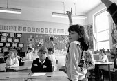 Girl answering a question during classroom lesson Primary School Birmingham - John Harris - 1980s,1988,answering,Birmingham,cities,city,class,classroom,CLASSROOMS,communicating,communication,EDU education,female,females,girl,girls,lesson,lessons,pedagogy,question,QUESTIONS,School,Schools,SER