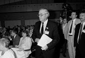 A smiling Eric Hammond EEPTU walking out of the TUC Congress 1988 prior to expulsion for undermining other trades Union agreements with employers (at News International Wapping) - John Harris - 05-09-1988