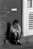School pupil eating a bag of chips for lunch in the street as the price of a school meal doubles. Bradford - John Harris - 1980s,1988,adolescence,adolescent,adolescents,BREAK,child,CHILDHOOD,children,chips,dinner,dinners,dinnertime,eating,EDU education,EQUALITY,excluded,exclusion,female,females,food,FOODS,girl,girls,HARDS