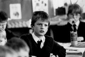 Boy listening in lesson Junior and Infants School in the Midlands - John Harris - 1980s,1988,attention,attentive,class,classroom,CLASSROOMS,EDU education,intelligence,intelligent,interested,learning,listening,reason,School,SCHOOLS,thinking,thought,Understanding