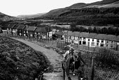 Women walking to the shops Penrhiwceiber, Cynon valley an area of low family income, poor housing and deprivation. South Wales 1989 - John Harris - ,1980s,1989,bought,buy,buyer,buyers,buying,closed,closing,closure,closures,commodities,commodity,consumer,consumers,customer,customers,ebf economy business,EQUALITY,excluded,exclusion,families,family,