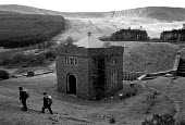 Walkers pass pumping station on the edge of a reservoir - John Harris - 1980s,1989,ACE,Architecture,arts,buildings,country,Countryside,culture,EBF economy business,Environment,Exercise,exercises,LFL leisure,outdoors,outside,pumping,Rambler,Ramblers,Rambling,reservoir,rese