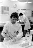 Forensic scientist extracting DNA sample for autoradiograph or genetic fingerprint from the scene of a crime. Police forensic laboratory Birmingham - John Harris - 13-03-1989