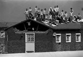 Prisoners on the roof of grisly Risley Remand Centre during an alleged riot which saw much of the prison destroyed. - John Harris - ,1980s,1989,activist,activists,Anger,CAMPAIGN,campaigner,campaigners,CAMPAIGNING,CAMPAIGNS,CLJ crime law & justice,DEMONSTRATING,DEMONSTRATION,DEMONSTRATIONS,imprisonment,incarcerated,incarceration,IN