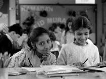Pupils making Eid decorations Junior and infant school Batley Yorkshire - John Harris - 1980s,1989,asian,BAME,BAMEs,black,BME,bmes,book,books,child,CHILDHOOD,children,class,decorations,diversity,EDU education,EMOTION,EMOTIONAL,EMOTIONS,ethnic,ethnicity,female,females,festival,FESTIVALS,g